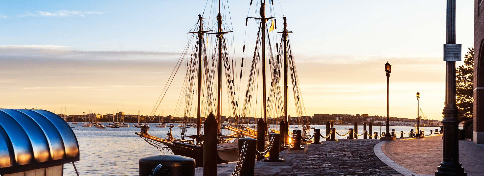 bollards and heavy chains by the moored tall ships in Boston Harbor